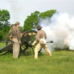 Re-enactors firing a cannon