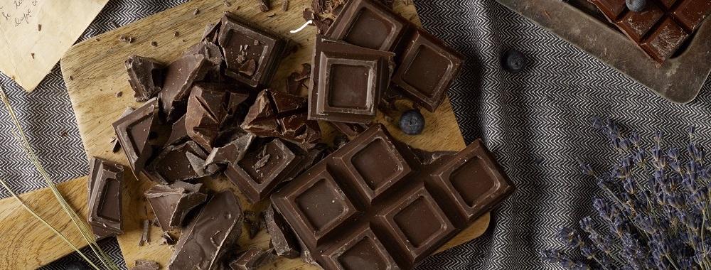 Dark chocolate on trencher - Shutterstock