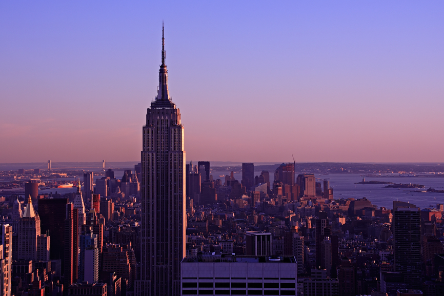 Aerial view of the Empire State Building at dusk, from the top of the Rockefeller Center - Manhattan, New York City, USA