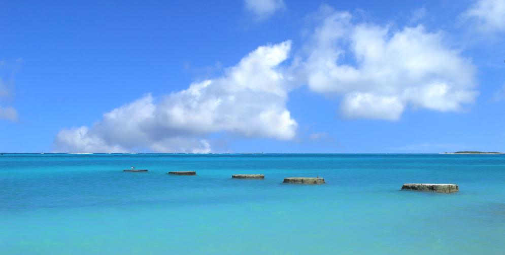 Beautiful coastal bay in Aruba with stone pillars in the water