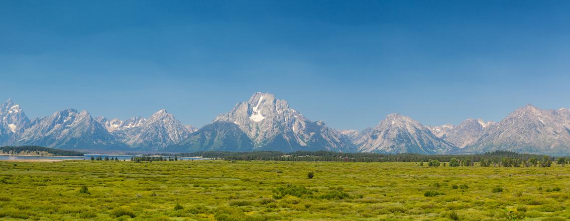 The amazing Teton mountains above Jackson Lake in Wyoming, USA. - panorama image