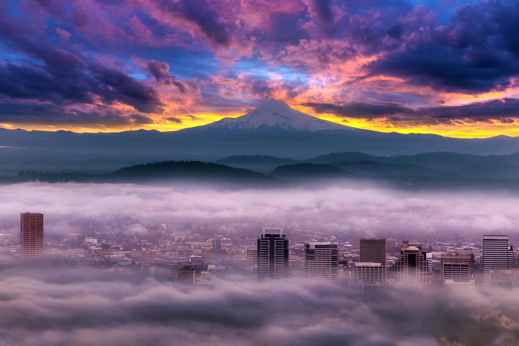 Dramatic colorful sunrise over Mount Hood and foggy Portland Oregon city downtown
